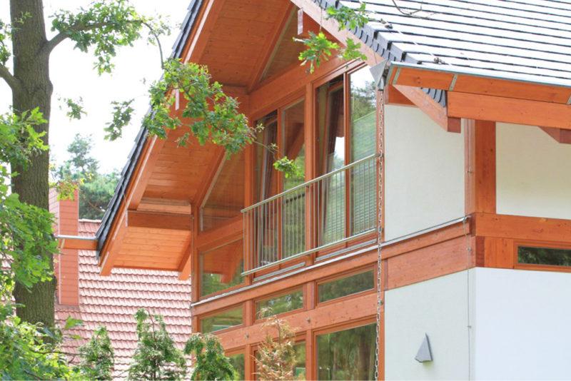 Concentus Modernes Fachwerk Holzskeletthaus Organge Braun