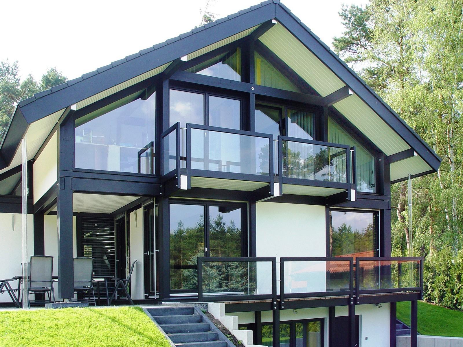 fachwerkhaus modern mit dunkler konstruktion und modernem. Black Bedroom Furniture Sets. Home Design Ideas